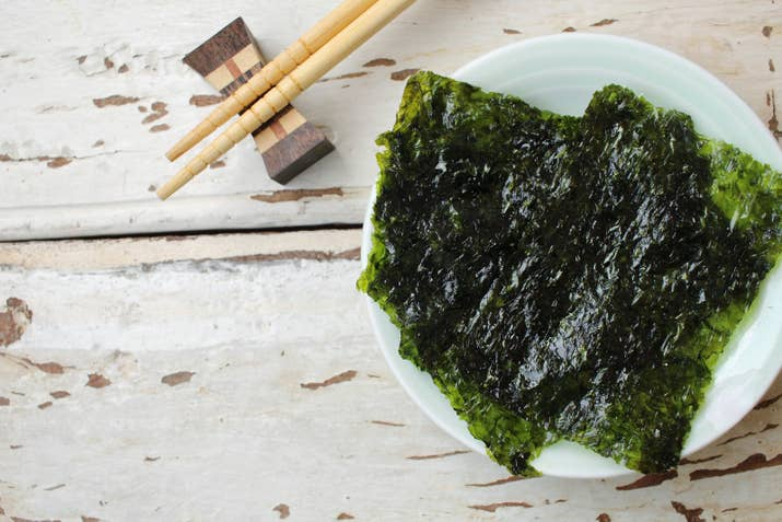 What is it? Toasted salted seaweed.You'll find a basket of salted seaweed in every Korean household. It's a staple side dish, but also makes a great snack and meal on-the-go when paired with rice. Recipe here.