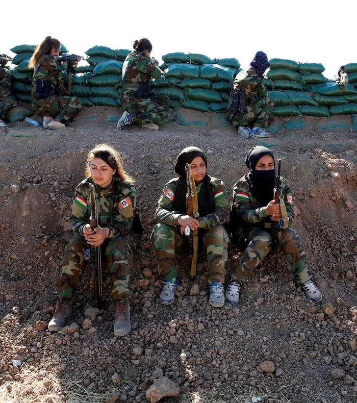 Iranian-Kurdish female fighters hold their weapons during a battle with Islamic State militants in Bashiqa, Iraq, on Nov. 3.