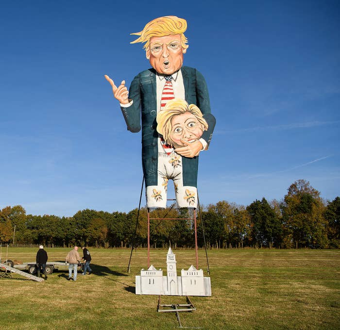 """Members of the Edenbridge Bonfire Society work to assemble their creation ahead an unveiling of this year's """"Celebrity Guy,"""" US presidential candidate Donald Trump, on Nov. 2 in Edenbridge, England."""