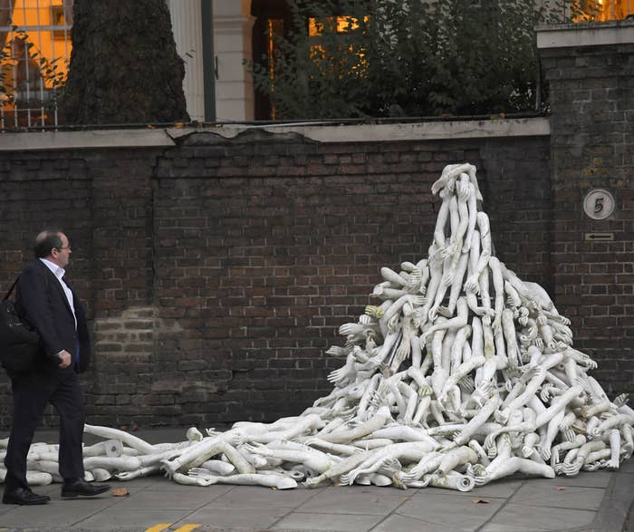Mannequin limbs are piled outside Russia's embassy in London as part of a protest against military action in Syria, on Nov. 3.
