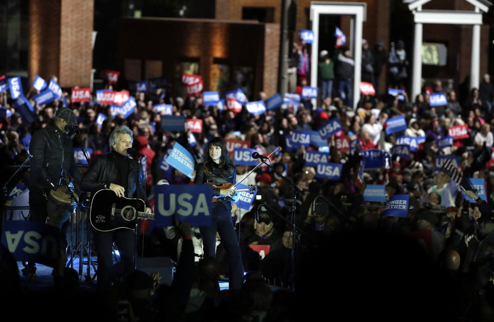 """Jon Bon Jovi kicked off the rally with songs that included the Beatles' """"Here Comes The Sun."""""""