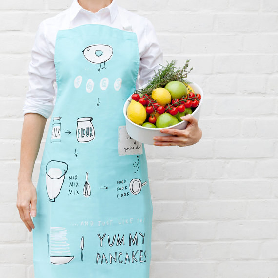This apron that will not only protect them while they're making the pancakes, it'll also provide them with the instructions!