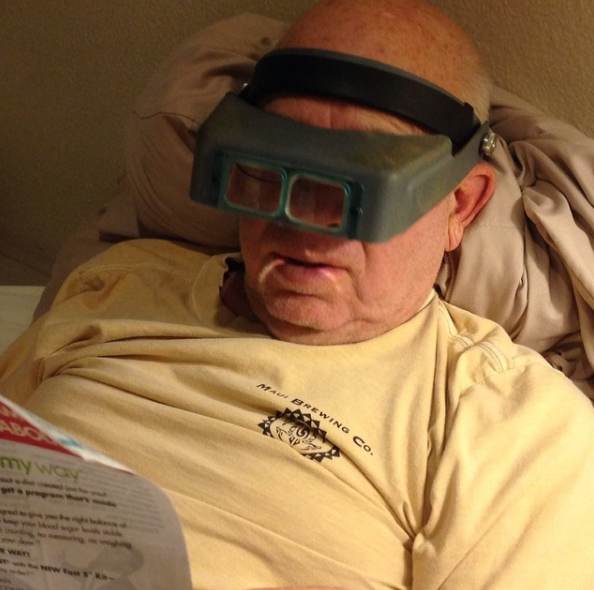 This dad who uses these amazing magnifying glasses to read.