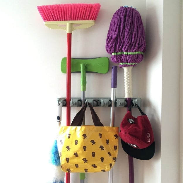 Quit dodging mops and brooms with this wall-mount grip.