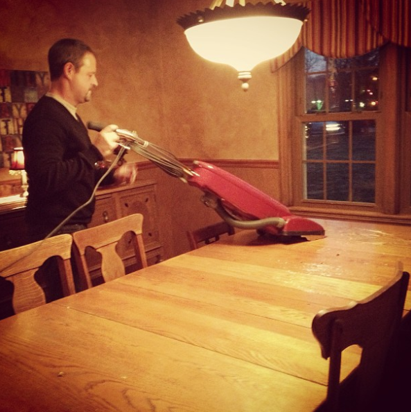 This dad who uses a vacuum to clean the table.