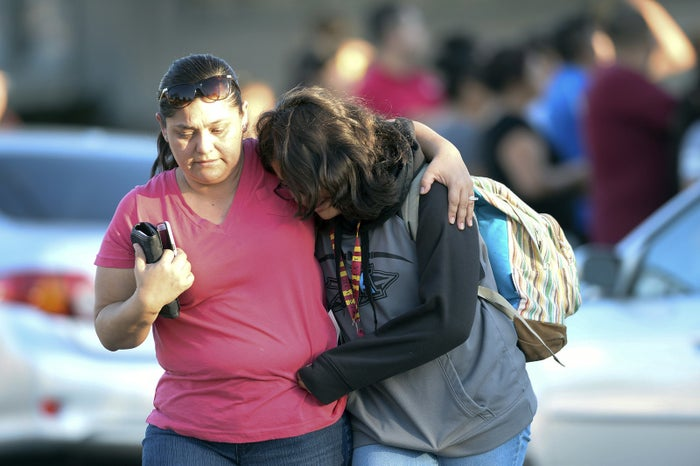 A parent picks up her daughter at Slauson Middle School that was on lockdown as police responded to the shooting.