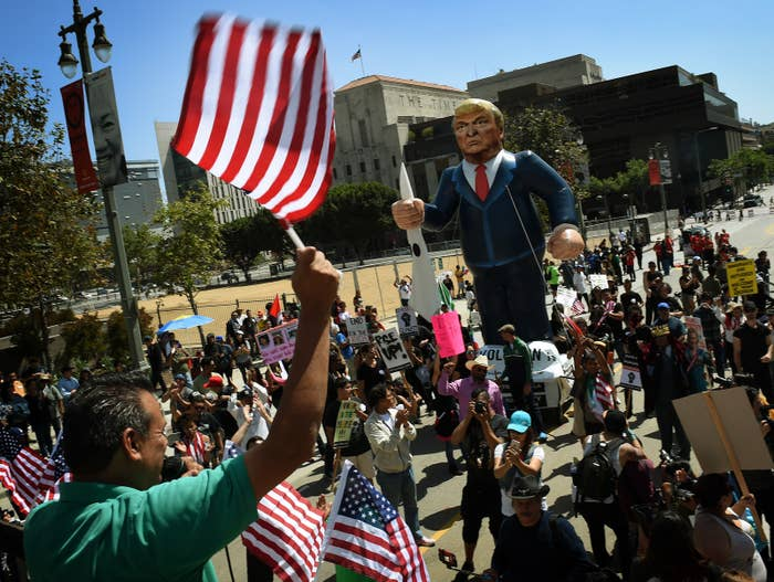 Protesters display a giant effigy of US Republican Party presidential hopeful Donald Trump during a protest on May Day in Los Angeles, California on May 1, 2016.