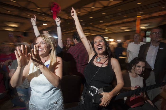 Supporters of Republican candidate Donald Trump, Stephanie Meza (L), 42, of Scottsdale, Arizona, and Rhonda Davis (R), 63, of Scottsdale, Arizona cheer as election results come in during a viewing party at a hotel in downtown Phoenix, Arizona on November 8, 2016.