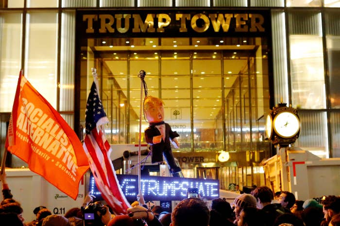 Protesters reach Trump Tower as they march against Republican President-elect Donald Trump.