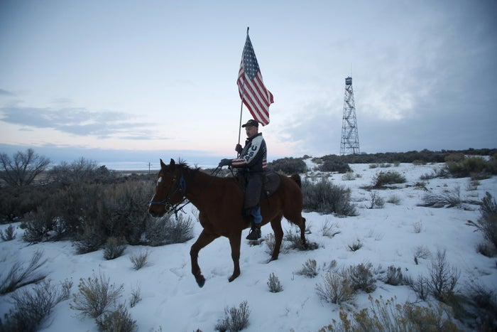 A man rides a horse during a standoff near Burns, Oregon, on January 7.