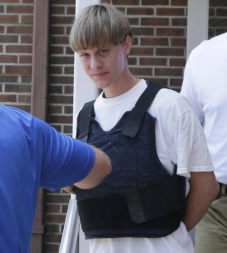 Dylann Roof is escorted from the Sheby Police Department in Shelby, N.C.