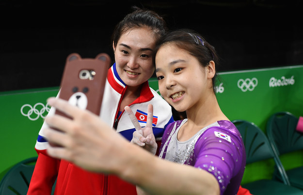 A North Korean and a South Korean gymnast taking a selfie together at the Rio Olympics.