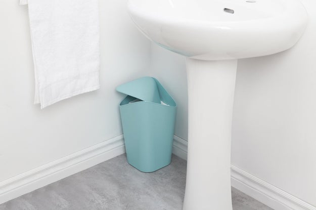 Squeeze in a lidded corner trash can that looks more like a sculpture than a receptacle for your dirty cotton swabs.
