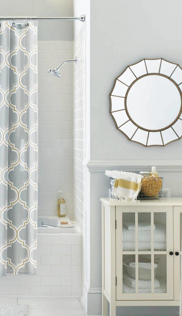 Replace the plain rectangle mirror that was there when you moved in with a pretty wall mirror.