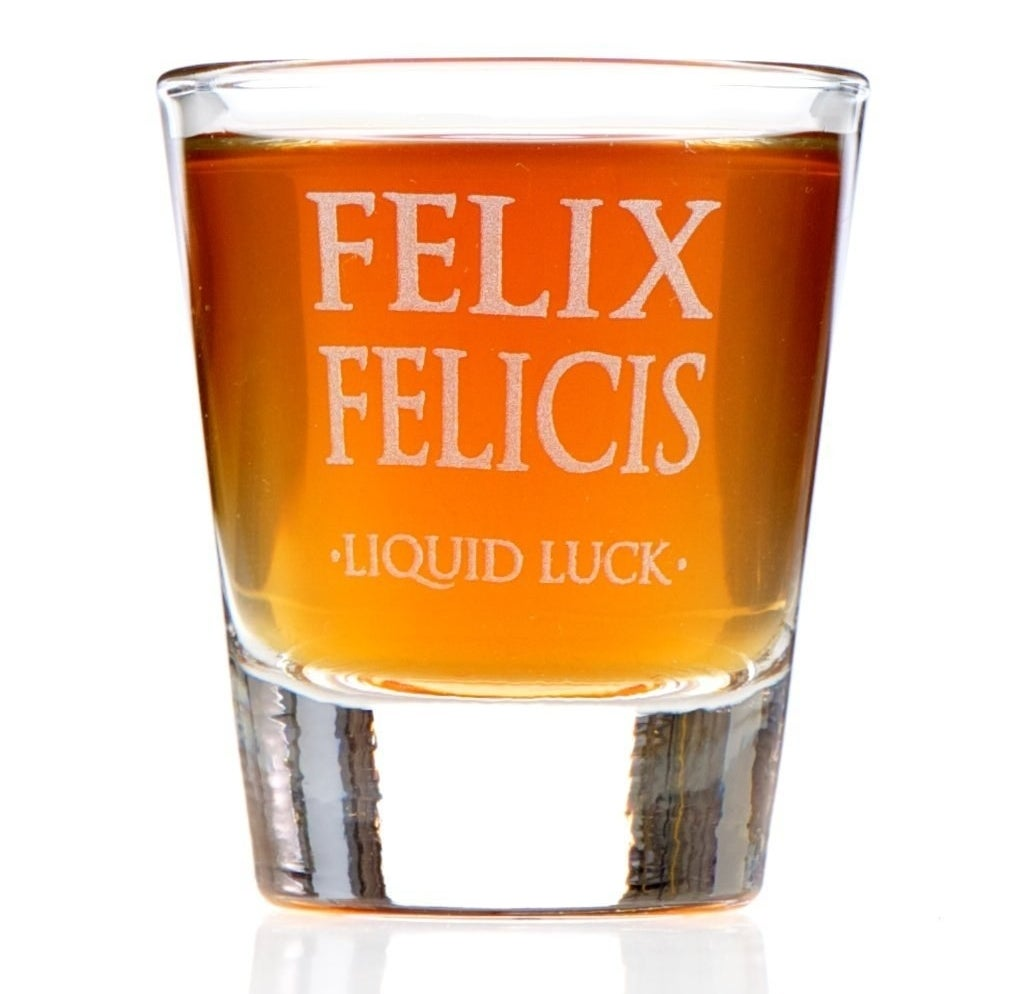 A shot glass that comes with a complimentary bottle of liquid luck.