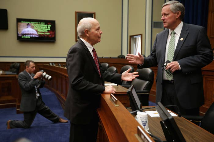 IRS Commissioner John Koskinen talks with Rep. Mark Meadows, the new chairman of the Freedom Caucus.