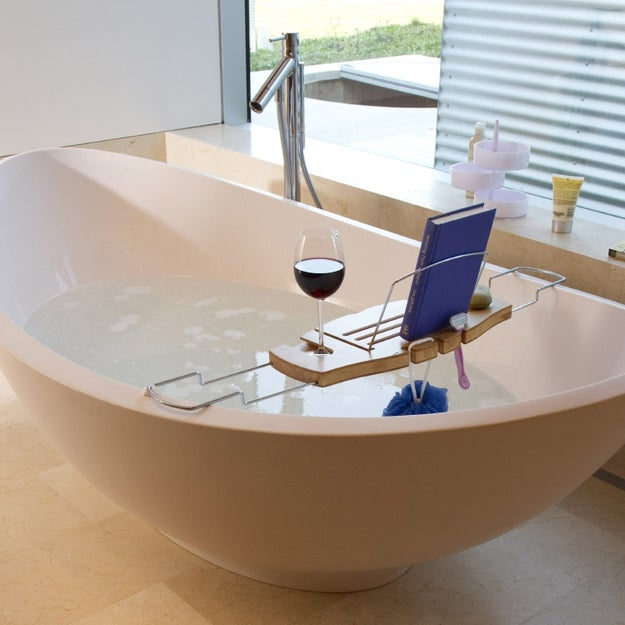 Soak into complete relaxation with a bathtub caddy that doesn't add bulk, just room for the essentials like a book, glass of wine, and soap.