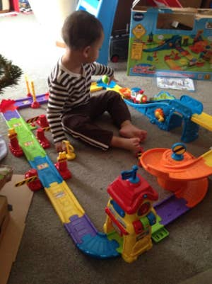 81e0a6d8efb 13. A Go! Go! Smart Wheels train station play set that lets kids connect  tracks and structures for toy trains.