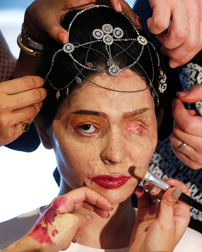 Indian model and acid attack survivor Reshma Quereshi has make up applied before walking to present Indian designer Archana Kochhar's Spring/Summer 2017 collections during New York Fashion Week on Sept. 8.