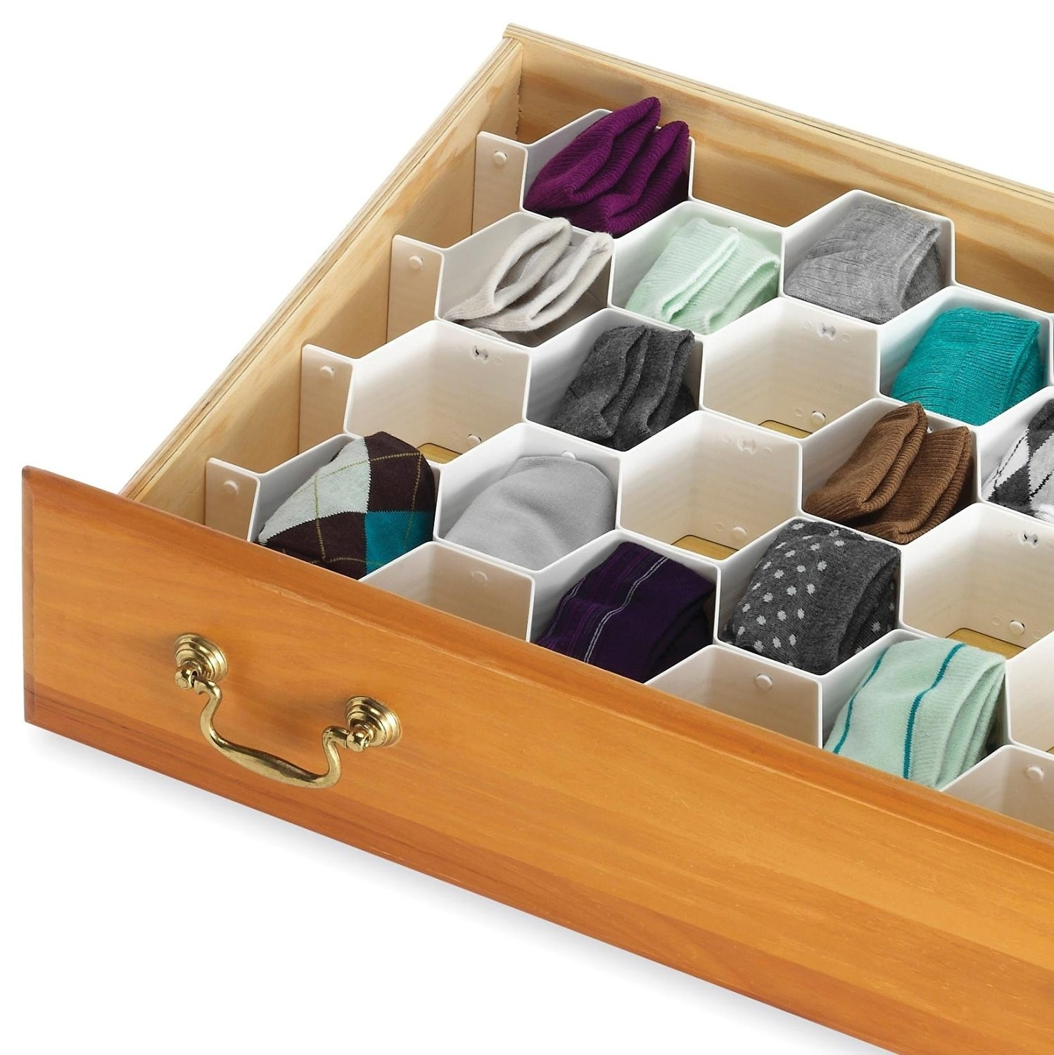 The honeycomb inserts placed inside a drawer.
