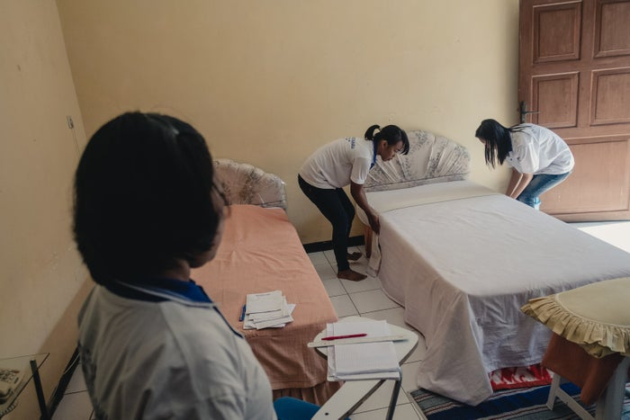 A bed-making class at PT. Dharma Kerta Raharja, a training center in Malang, located in East Java, Indonesia, for women seeking work as foreign domestic workers in Hong Kong, Taiwan, and Singapore. The center doesn't charge students for enrollment, but deducts a fee from future salaries.