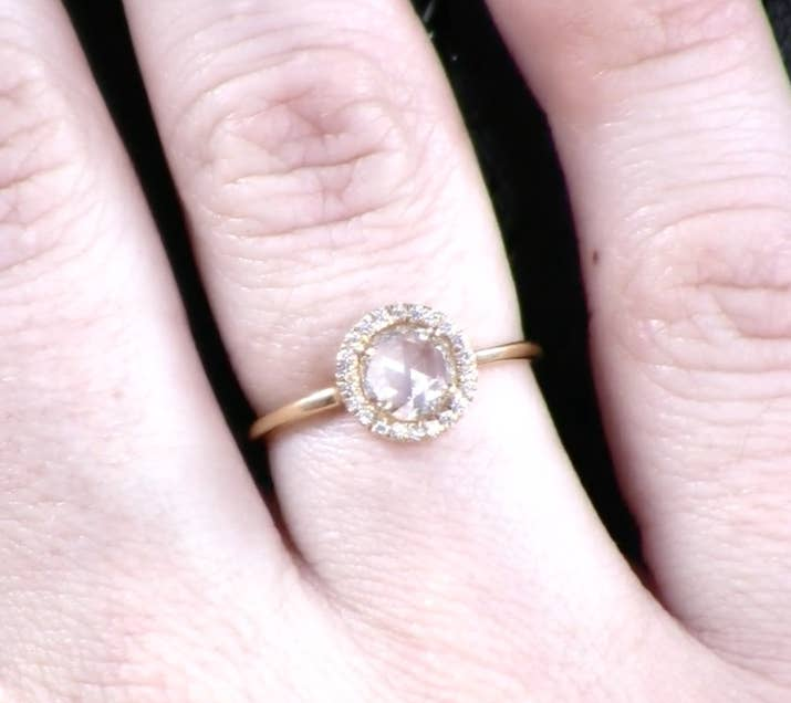 "You know how we said that brilliant cut diamonds have that pointy bottom? Well, a rose cut has a flat bottom, which means that the stone can have a large appearance while still weighing considerably less. ""Prices tend to go down on a rose cut stone since you're getting less carat weight,"" jewelry designer Anna Sheffield told BuzzFeed."