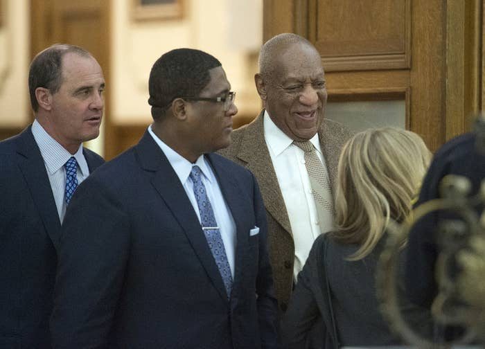 Bill Cosby inside the courtroom with the help of an aid flanked by lawyer Brian McMonagle, far left with fellow counsel Angela Agrusa, right.