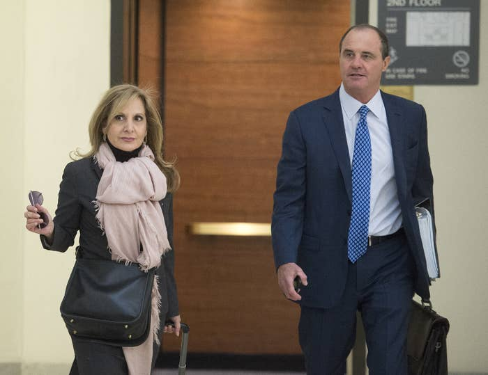 Brian McMonagle, right, walks with counsel Angela Agrusa, left, as they arrive for the pretrial hearing on Dec. 14, 2016.