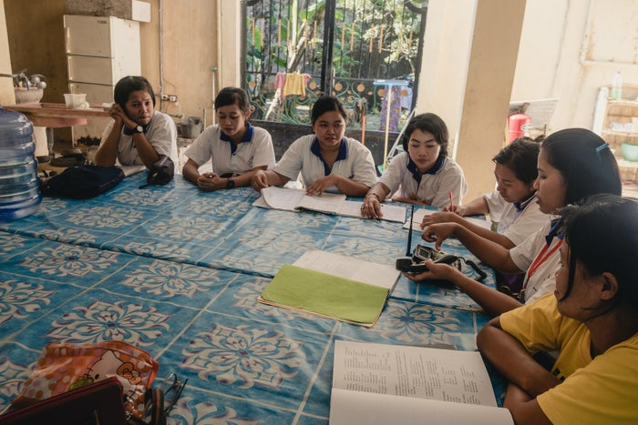 A class in telephone etiquette at PT. Dharma Kerta Raharja. Other classes instruct on how to do laundry, take care of elderly people, cook, operate appliances, and make beds. Foreign language classes are also offered.