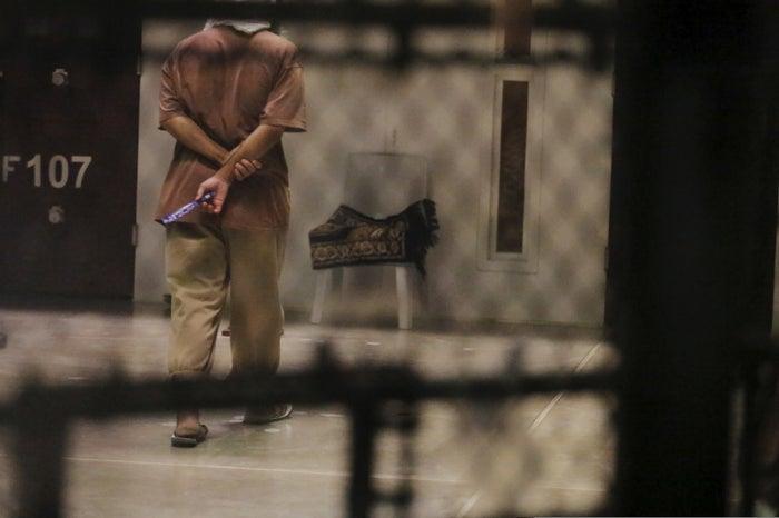 A prisoner walks in the Guantanamo Bay detention facility.