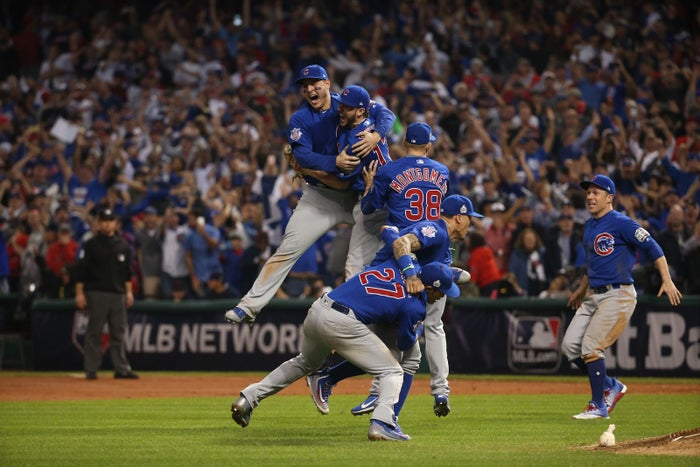 The Chicago Cubs celebrate after defeating the Cleveland Indians in Game 7 to win the World Series 8-7 at Progressive Field in Cleveland, Nov. 3, 2016.