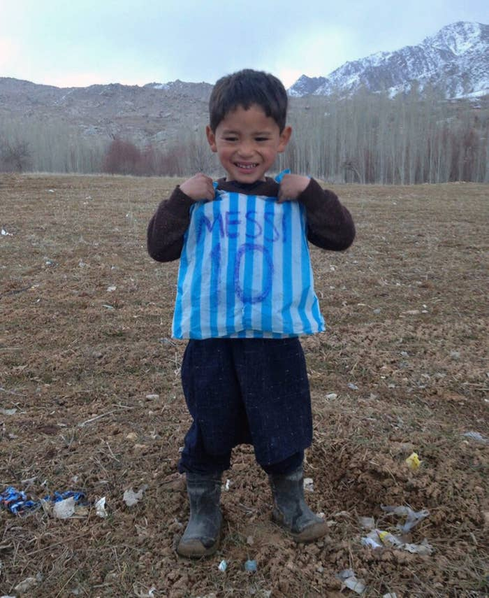 """Murtaza was living with his family in a remote village in the Ghazni province of Afghanistan at the time.He was known in his village as """"Messi's biggest fan"""" and was often seen playing football on the streets with a rival child who is known as """"Ronaldo's biggest fan."""""""