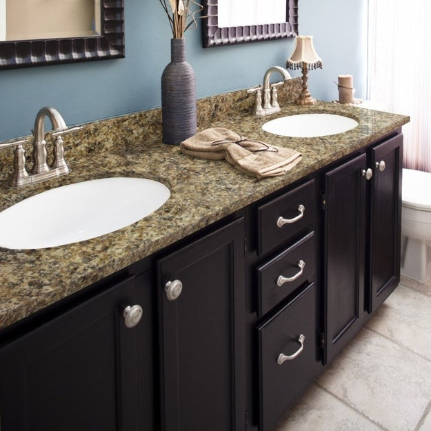 Sponge on a pricey looking faux-stone countertop -- at a fraction of the cost for the real deal -- with a granite paint kit.