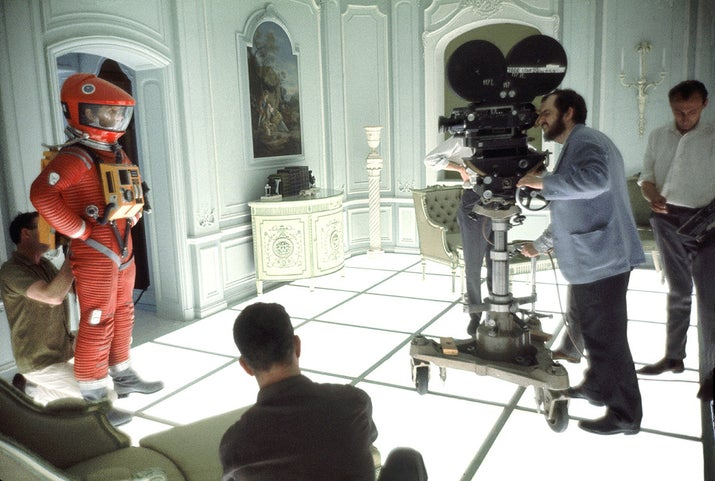 Director and screenwriter Stanley Kubrick finds his shot on the set of 2001: A Space Odyssey at the MGM British Studios in Borehamwood, England. On the left is American actor Keir Dullea in a spacesuit.