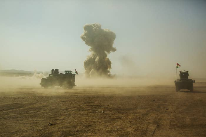 Kurdish special forces blow up an ISIS car bomb as it approaches their convoy.