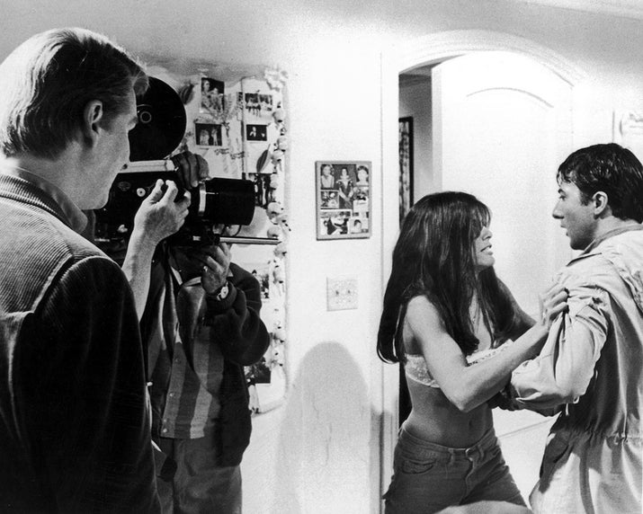 Director Mike Nichols watches as actors Katharine Ross and Dustin Hoffman act in a scene from The Graduate.
