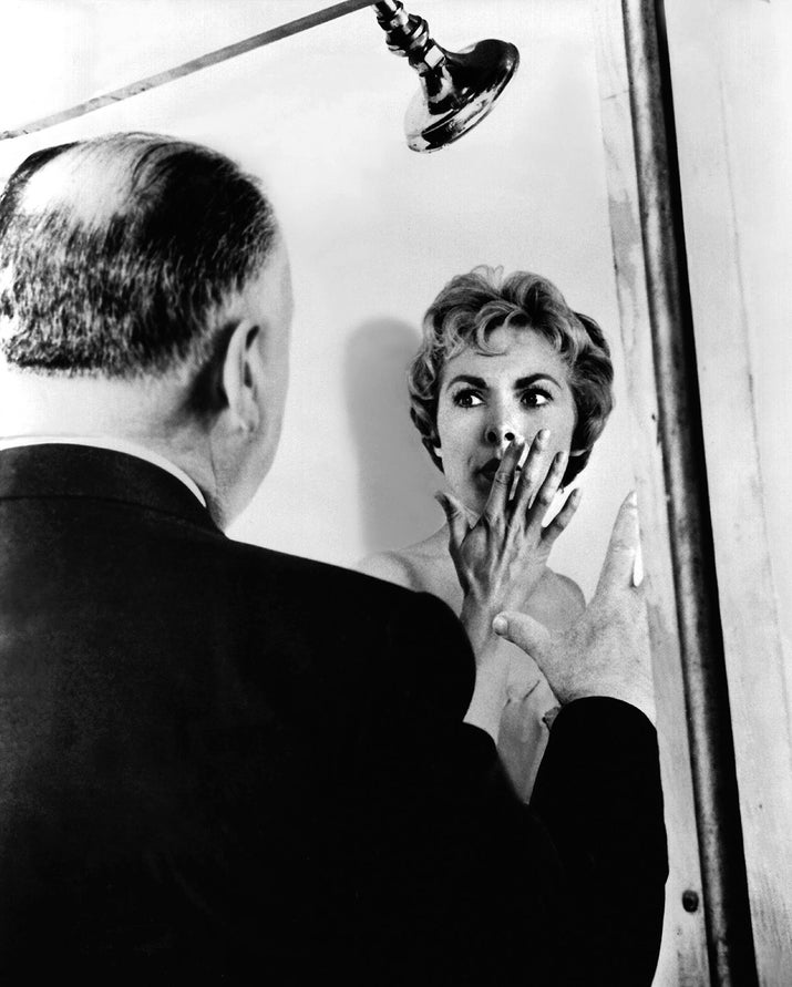 Director Alfred Hitchcock and actor Janet Leigh on the set of Psycho.