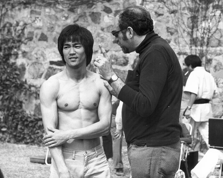 Actor Bruce Lee with producer Fred Weintraub on the set of Enter the Dragon.