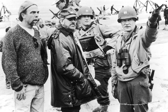 Director Steven Spielberg on the set of the film Saving Private Ryan.