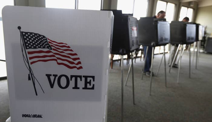 Voters cast their ballots in the Illinois primary in Hinsdale, Ill. I