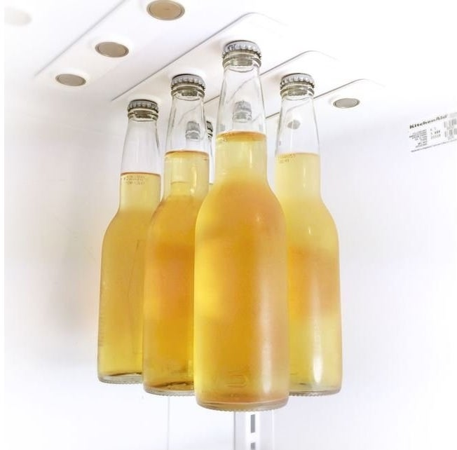 Levitate your beer bottles above other fridge inhabitants with magnetic bottle strips made to fit on the roof of your fridge.