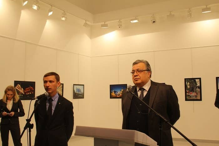 Andrey Karlov, right, speaking at the art exhibition on Monday.