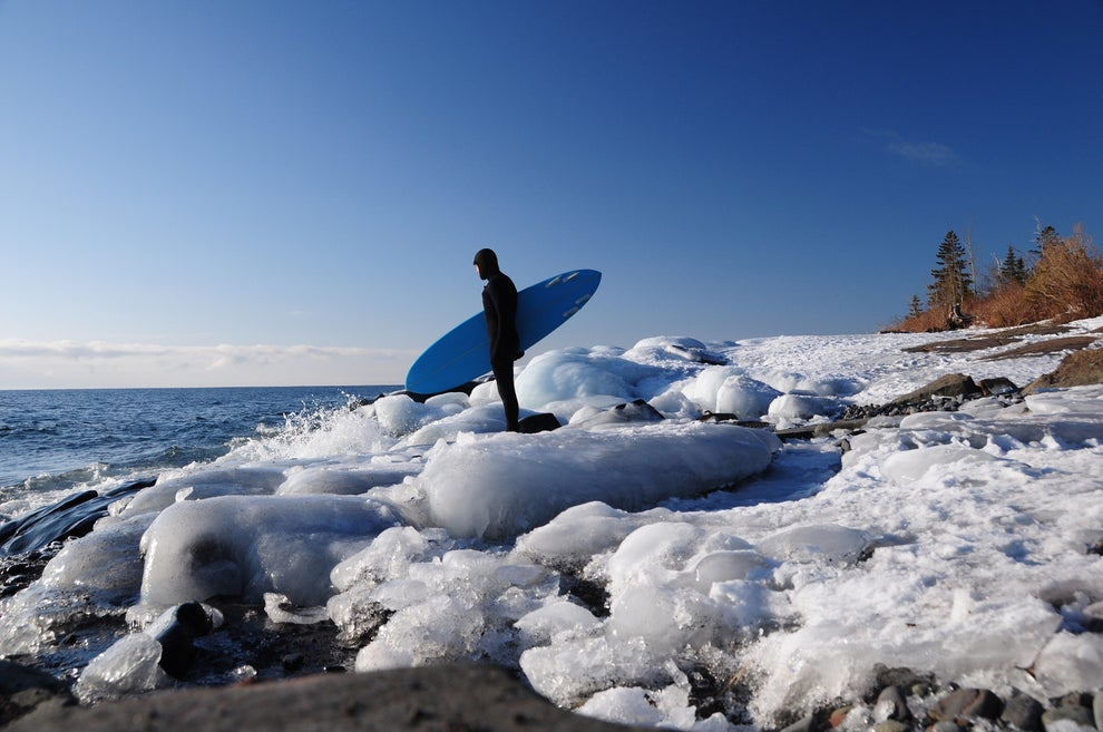 Brave the water by winter surfing...