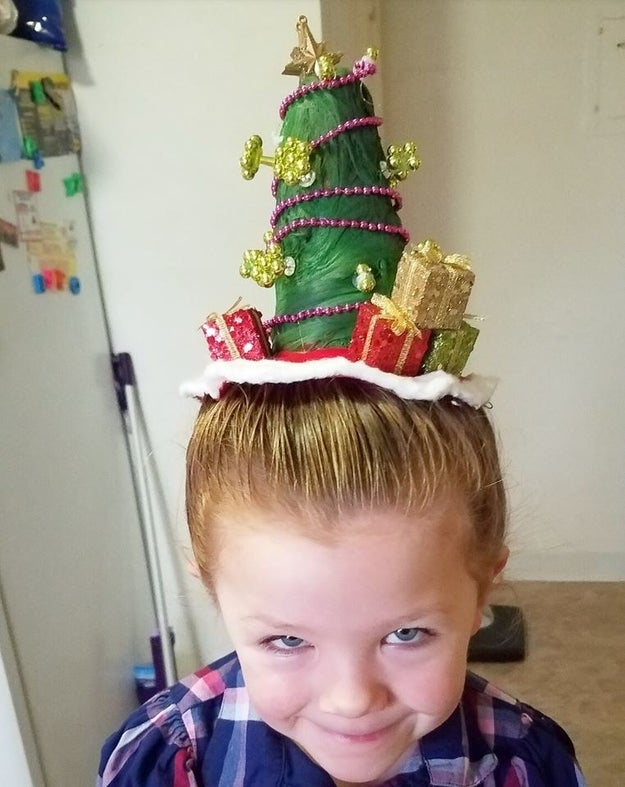 Wickherst told BuzzFeed he celebrated the holiday season at Izzy's school by giving her extravagant hairstyles, like this adorable Christmas tree complete with presents.