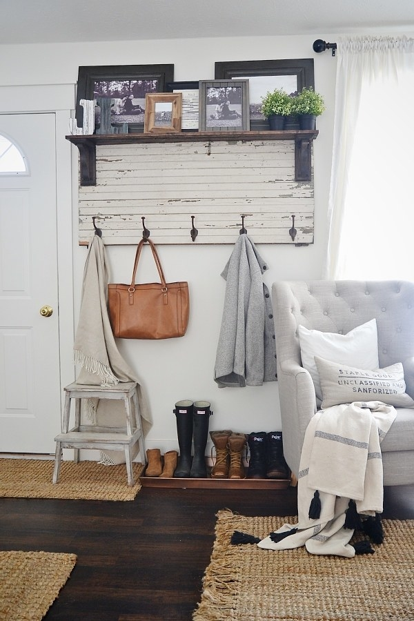 Carve out some space for a (pretty) mudroom with a rustic entryway coat rack and a few storage accessories to complete the nook.