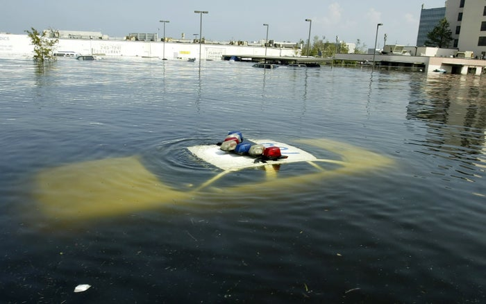 A police car is submerged in New Orleans East after Hurricane Katrina hit the area.