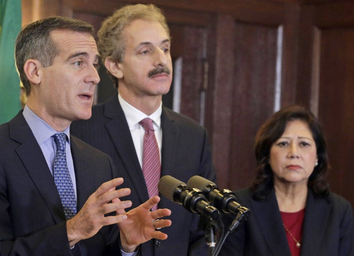 Los Angeles Mayor Eric Garcetti, left, City Attorney Mike Feuer and Los Angeles County Supervisor Hilda Solis announce the fund.