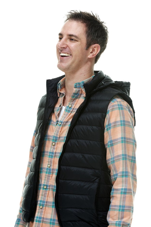 Vests over button-ups.