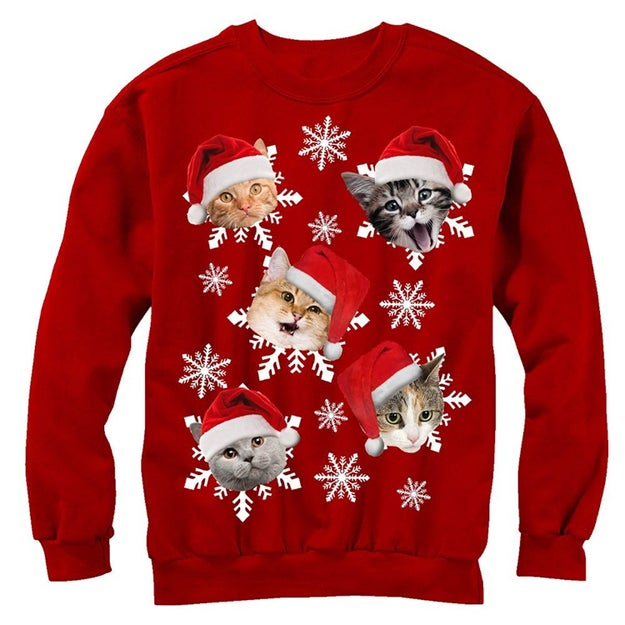 A sweatshirt covered in terrified-looking Santacats.