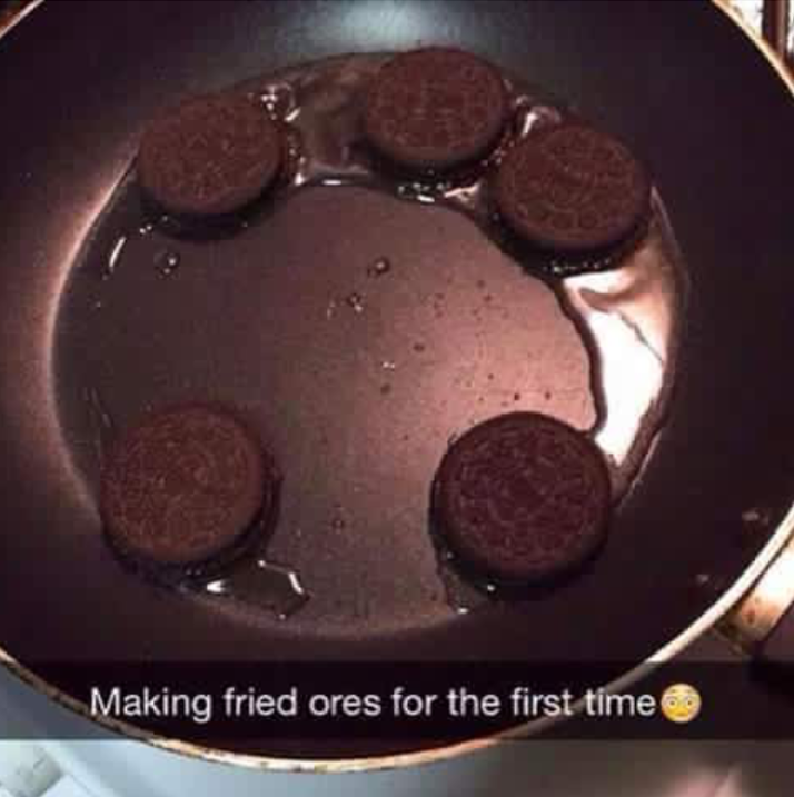 person cooking oreos in oil